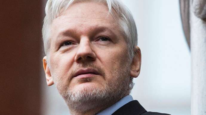 image for Assange Additionally Charged with Injuring Government Lamp