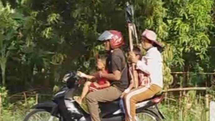image for New Fad Of Carrying An Intravenous Drip Whilst Riding A Motorcycle, Sweeping Through City