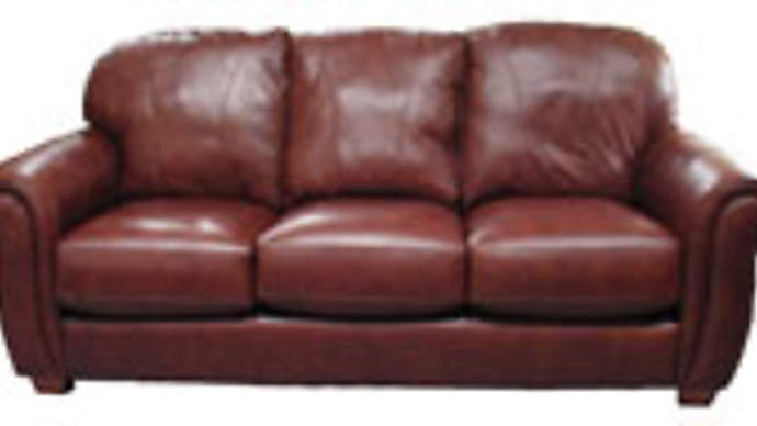 image for Oprah to sell off sofa that Tom Cruise jumped on