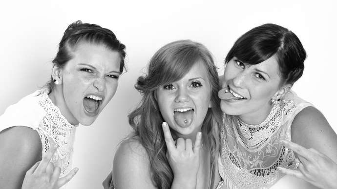 image for Three Women Pull Faces At Photographer