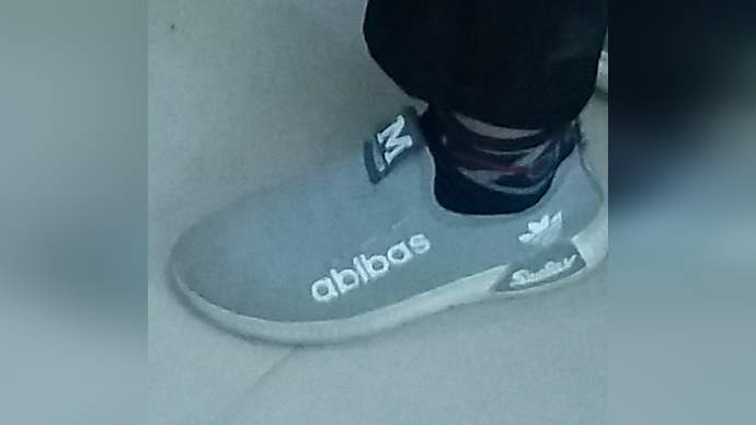 image for Man Spotted Lad Wearing Fake Adidas Trainers