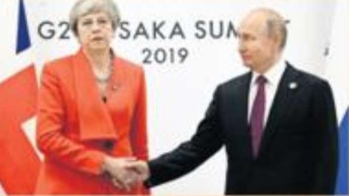 image for Vladimir Putin Disables Theresa May With Handshake And A Kiss