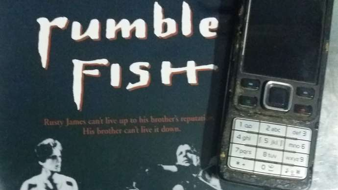 image for Man's Telephone Has Lost Its Color Function, And Is Now Black-And-White Only, Like 'Rumble Fish' (1983)