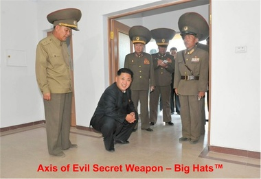 image for North Korean Dictator Kim Jong Un Seriously Injured by Generals Losing Balance From Giant Hats and Falling on Him