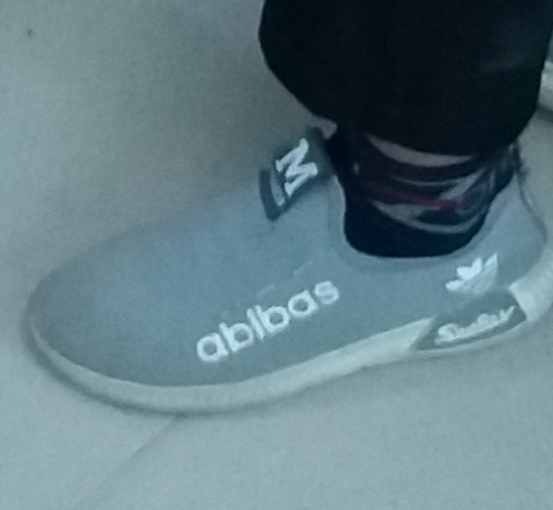17debd7f01a7 Man Spotted Lad Wearing Fake Adidas Trainers - The Spoof