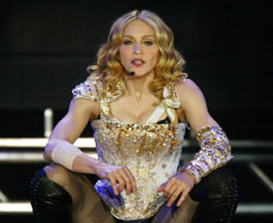 image for Madonna quits show biz; press blames her tits